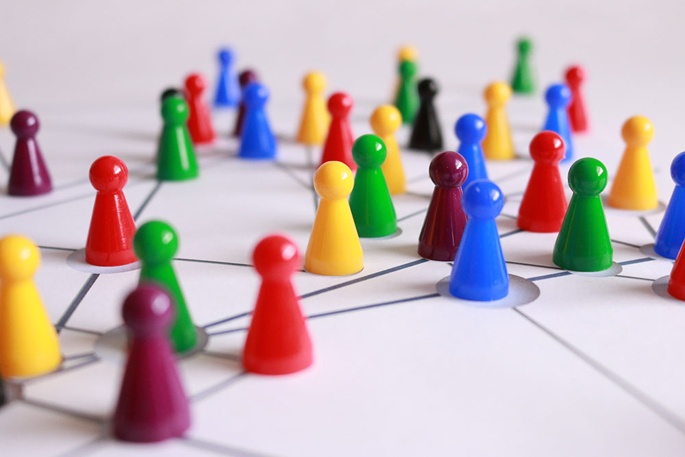games pieces to symbolize networking