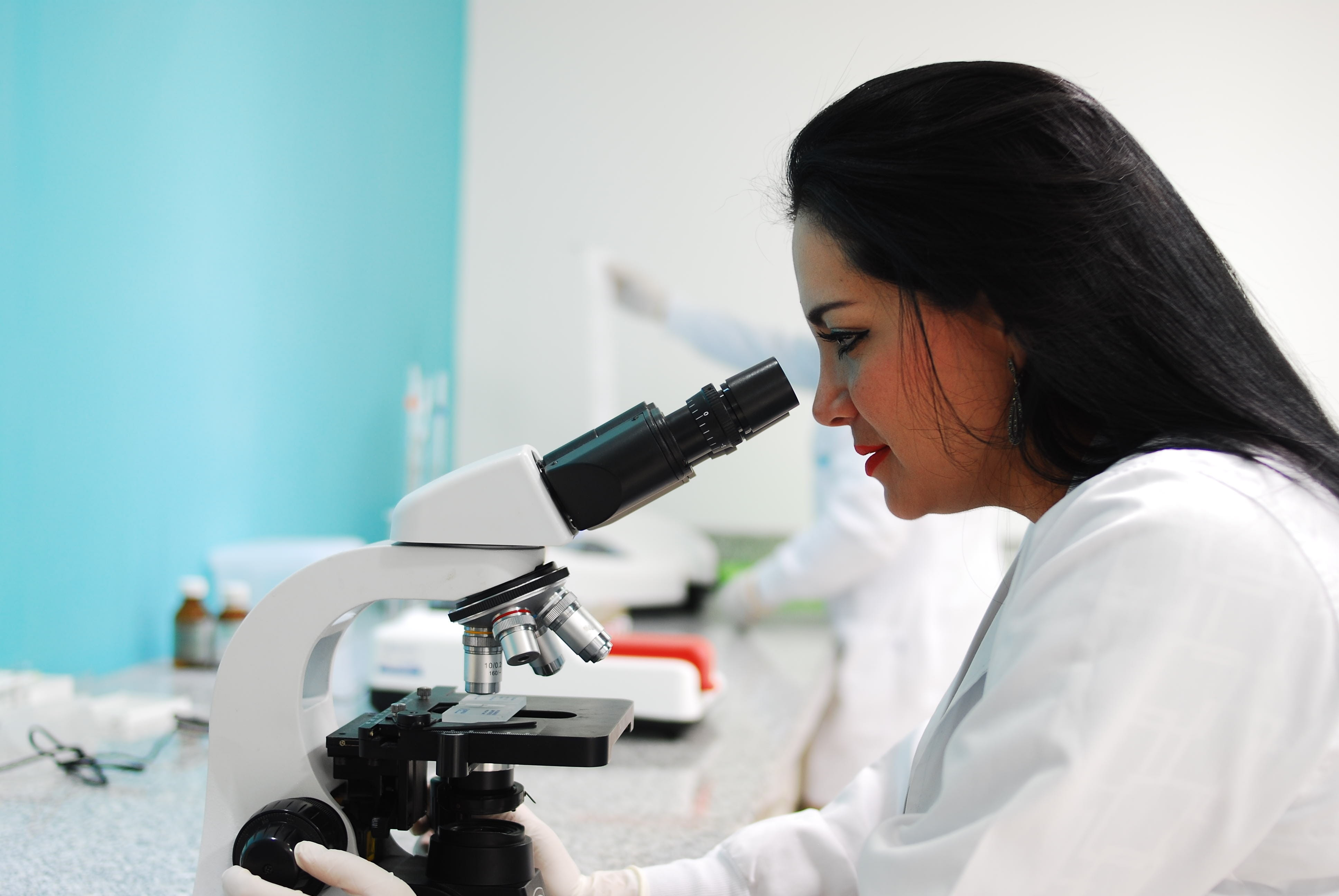 Scientist at work at a microscope