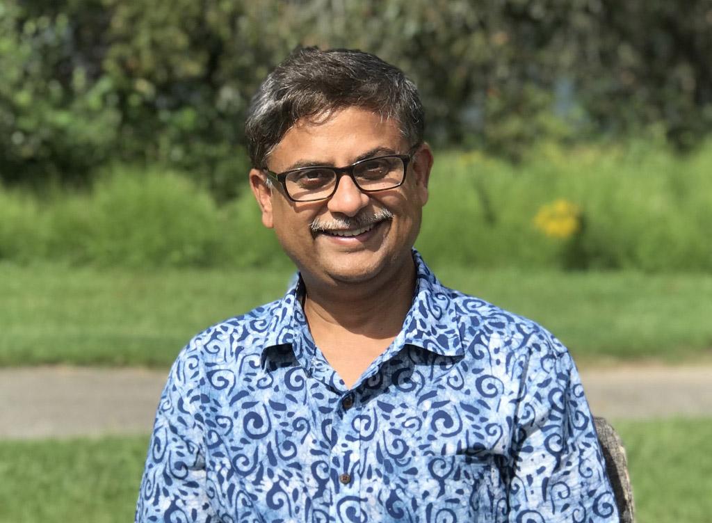 headshot of Vedham Karpakakunjaram
