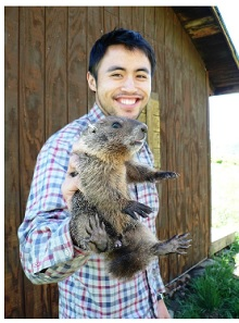 Researcher holding marmot